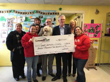 Lowell Five handing an oversized check to Staff of Humane Society