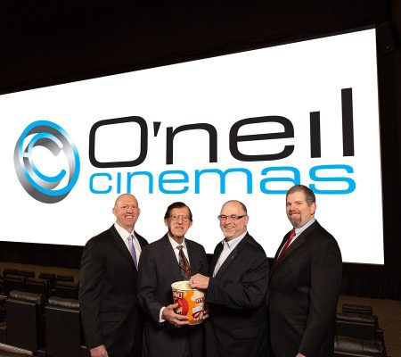 Dan O'Neill Sr, president and CEO of O'neil Cinemas, Executive Vice Presidents Daniel R. O'Neil and Timothy M. O'Neil with Lowell Five Bank Chief Lending Officer Don Bedard.